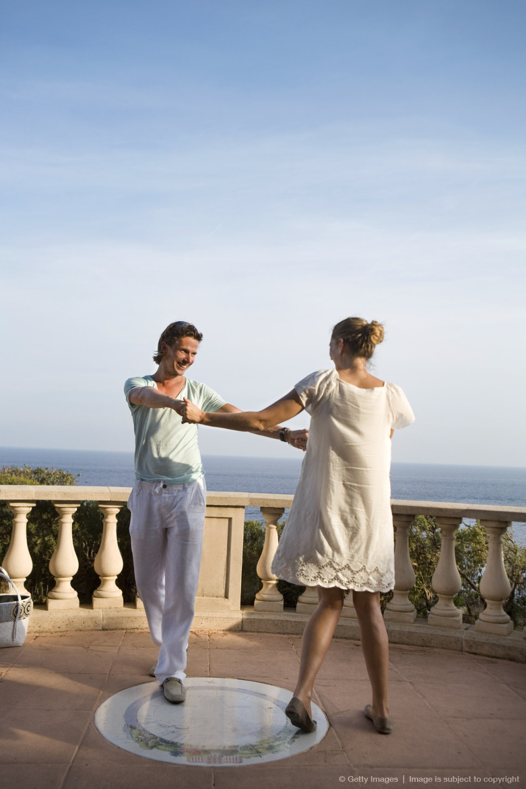 loving couple dance on balcony