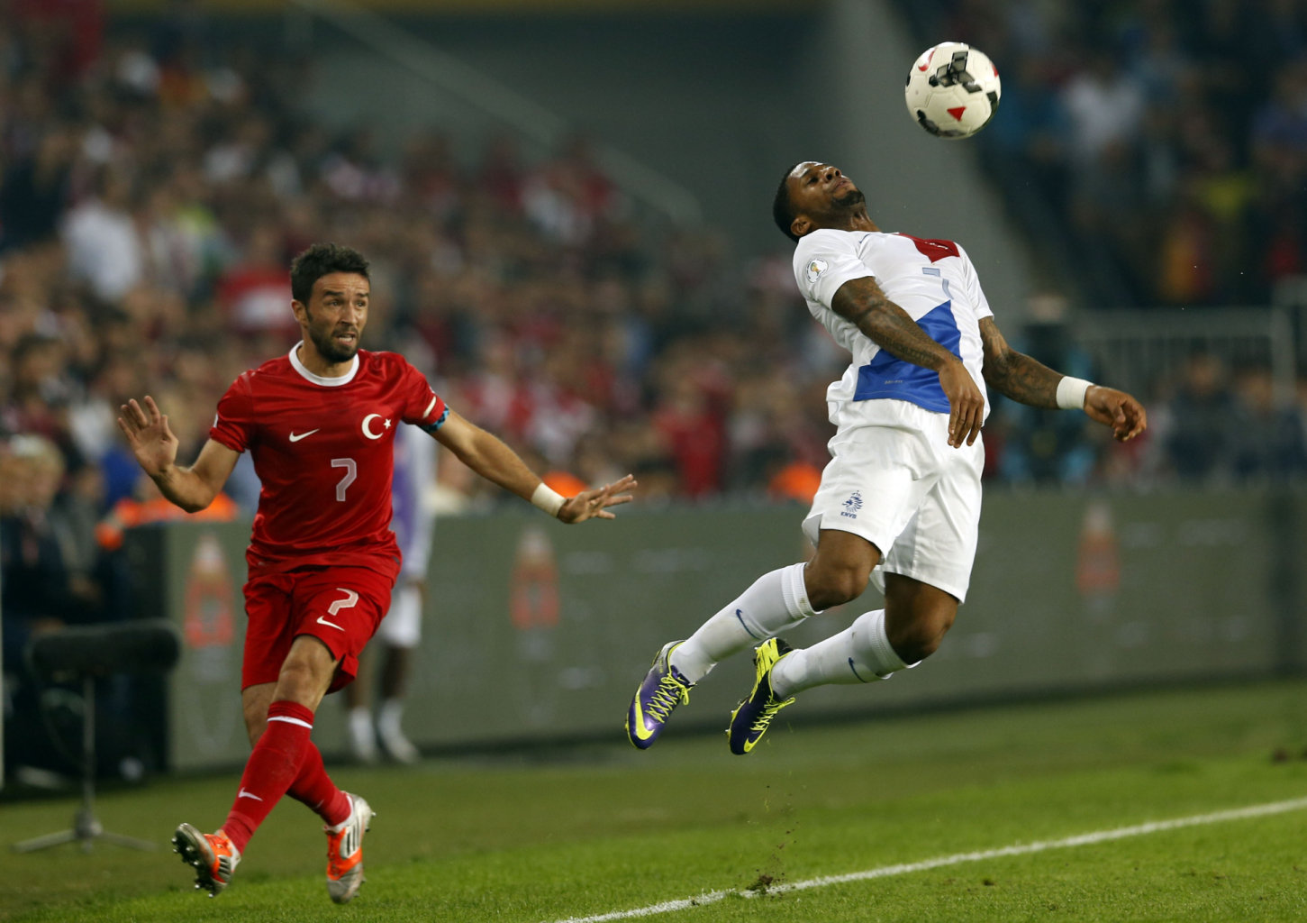 Netherlands' Lens controls ball in front of Turkey's Gonul during 2014 World Cup qualifying soccer match in Istanbul
