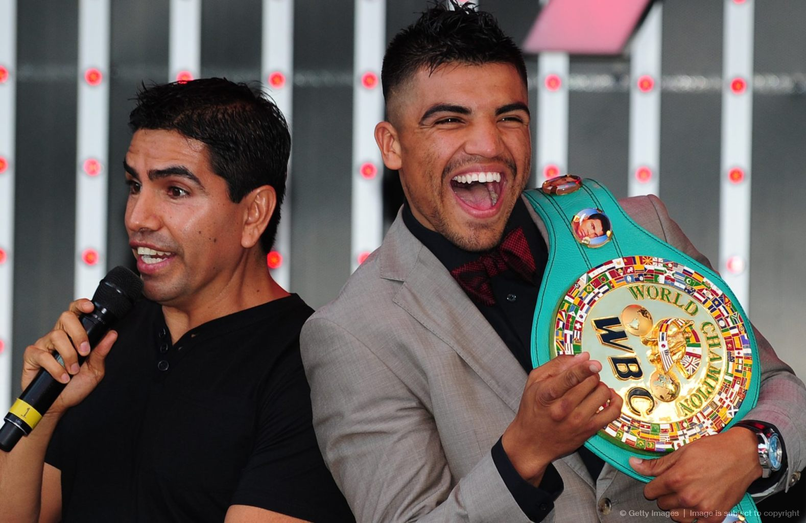Boxers Victor Ortiz (L) and Vivian Harri